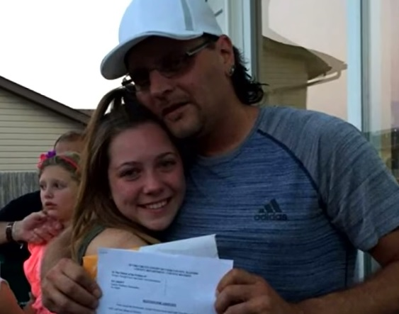 Time to cry: This 18-year-old girl surprised her Mom's boyfriend with adoption papers at her graduation party
