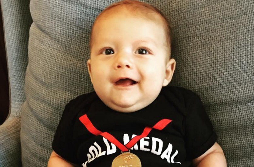 Boomer Phelps' (aka, Michael Phelps' tiny baby) gold booties are all we can think about, really