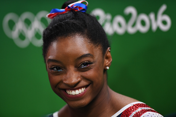 15 photos of Simone Biles smiling that will ensure you're never sad again