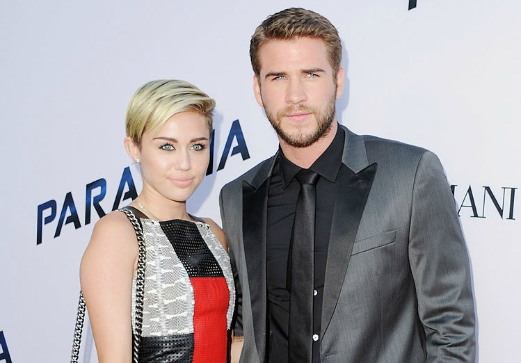 Miley Cyrus and Liam Hemsworth are super cute together at this bizarrely themed party