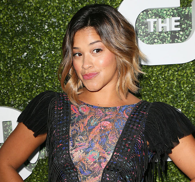 Gina Rodriguez is feelin' herself in a '70s-inspired top —and it's only $18
