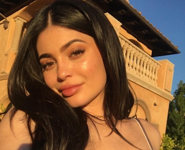Kylie Jenner and her bleach blond hair just landed in NYC for Fashion Week