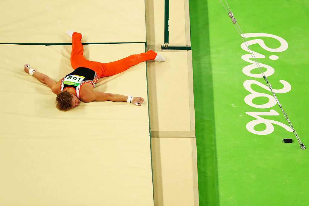 Watching this Olympian face plant from his high bar makes us forever cringe