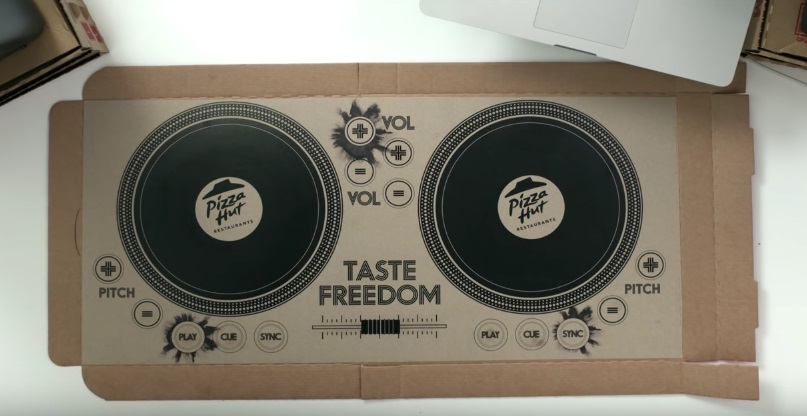 Pizza Hut just introduced a TURNTABLE pizza box and yes, this is real life