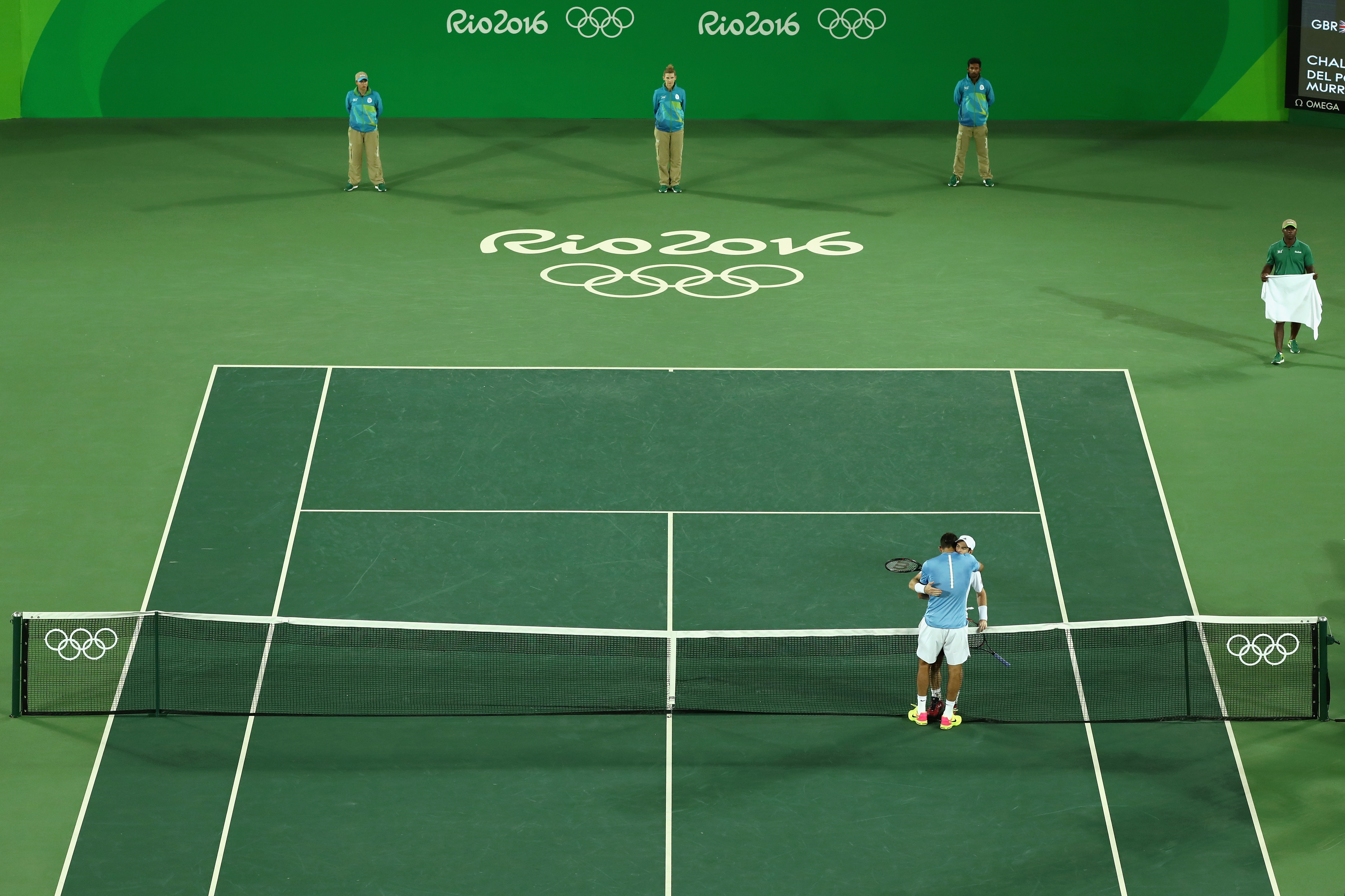 Man uses Olympic tennis court as giant green screen, and we're all winners