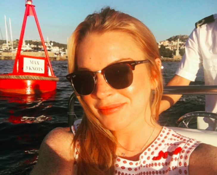 We have a lot of questions about Lindsay Lohan's latest post with her engagement ring