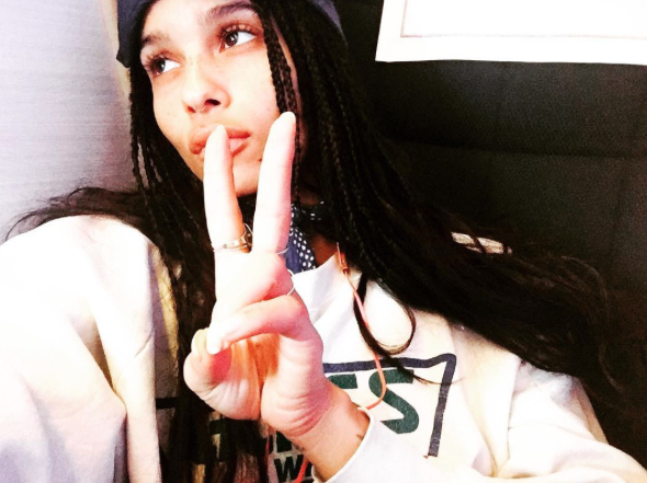 Zoë Kravitz wore an *amazing* oversized jean jacket to perform at a music festival, and we want one ASAP