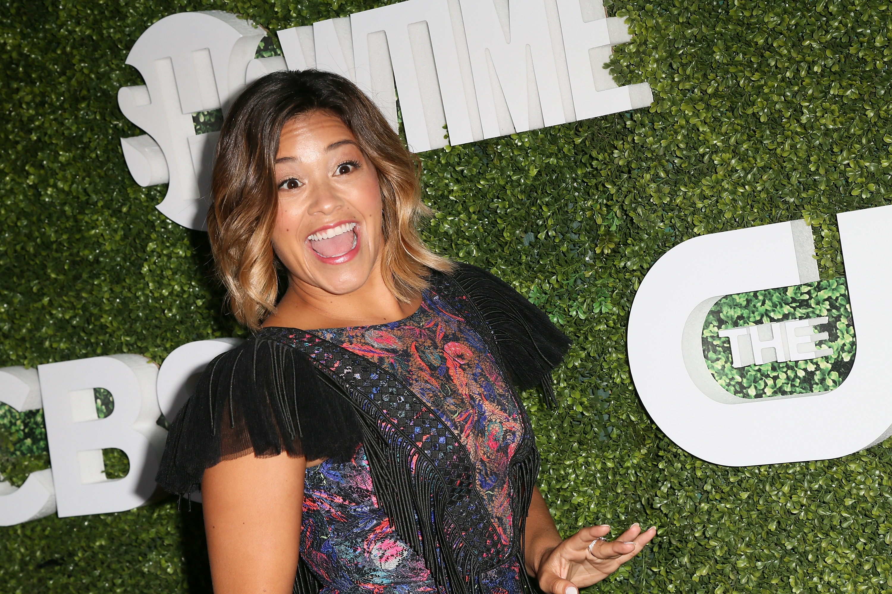 Gina Rodriguez DGAF what people think about her half-shaved head and we couldn't agree more