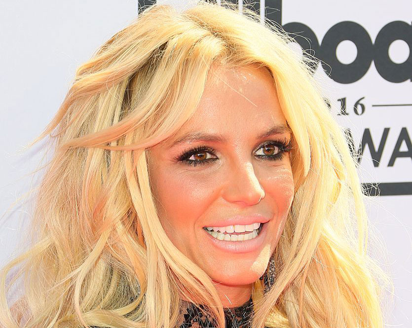 Britney Spears just teased us with a Super Bowl performance and we hope it comes true