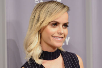 Taryn Manning flaunts a colorful '80s-inspired jacket, and it is totally tubular
