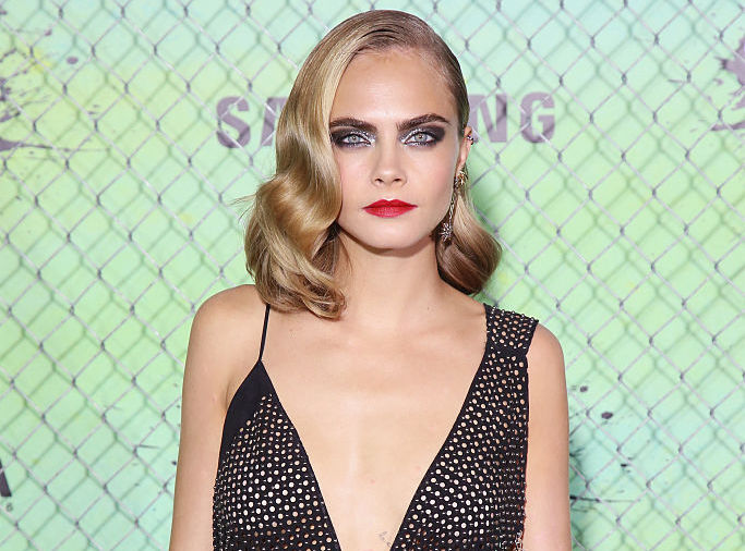 Cara Delevingne covers her lady garden with a flower — to promote an important cause for women