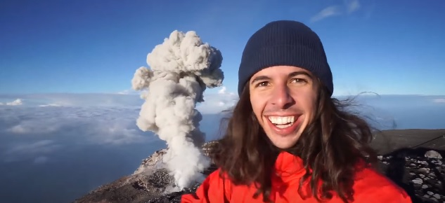 This guy just stood above an erupting volcano like it's NBD and the footage is terrifyingly beautiful