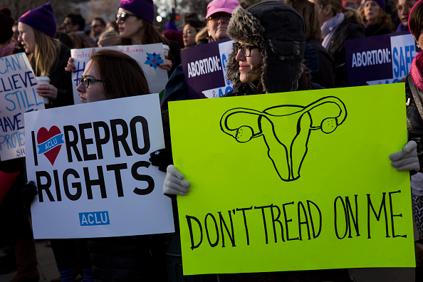 WASHINGTON, DC - MARCH 02: Pro-choice advocates rally outside of the Supreme Court on March 2, 2016 in Washington, DC. On Wednesday morning, the Supreme Court will hear oral arguments in the Whole Woman's Health v. Hellerstedt case, where the justices will consider a Texas law requiring that clinic doctors have admitting privileges at local hospitals and that clinics upgrade their facilities to standards similar to hospitals. (c)