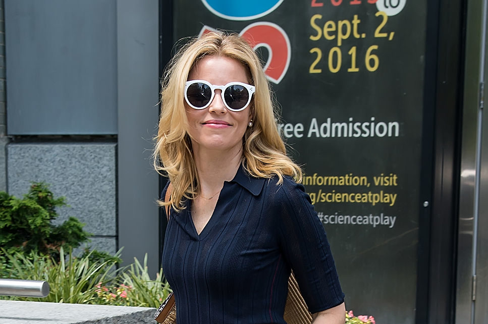 Elizabeth Banks drinks her coffee from a mug that is literally badass