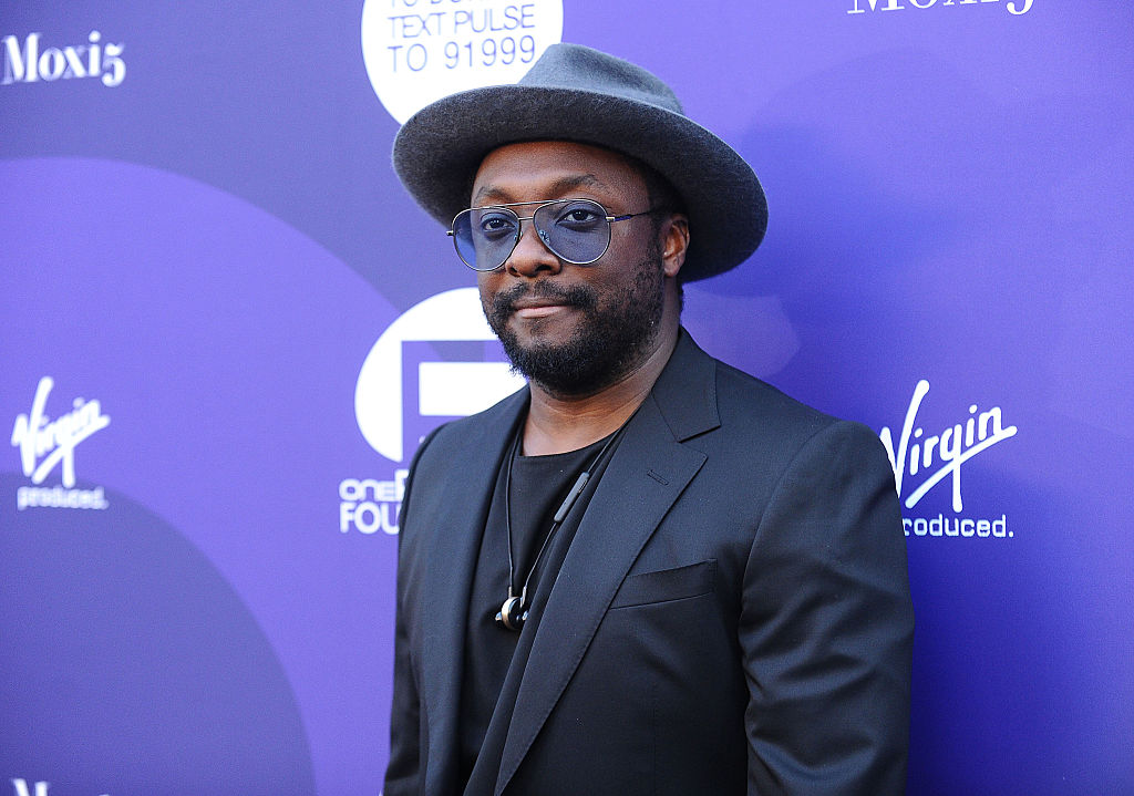 James Corden caught Will.i.am using his suitcase as a sled at the airport and it was magical