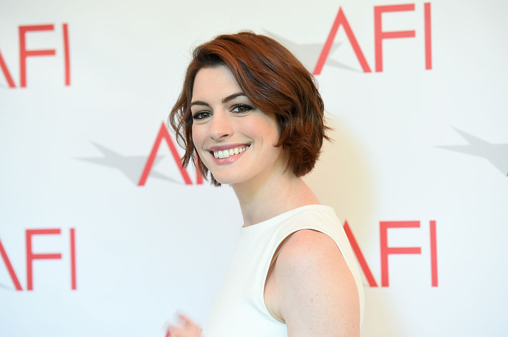 Anne Hathaway just talked about fitting back into her pre-pregnancy clothes in the most relatable way