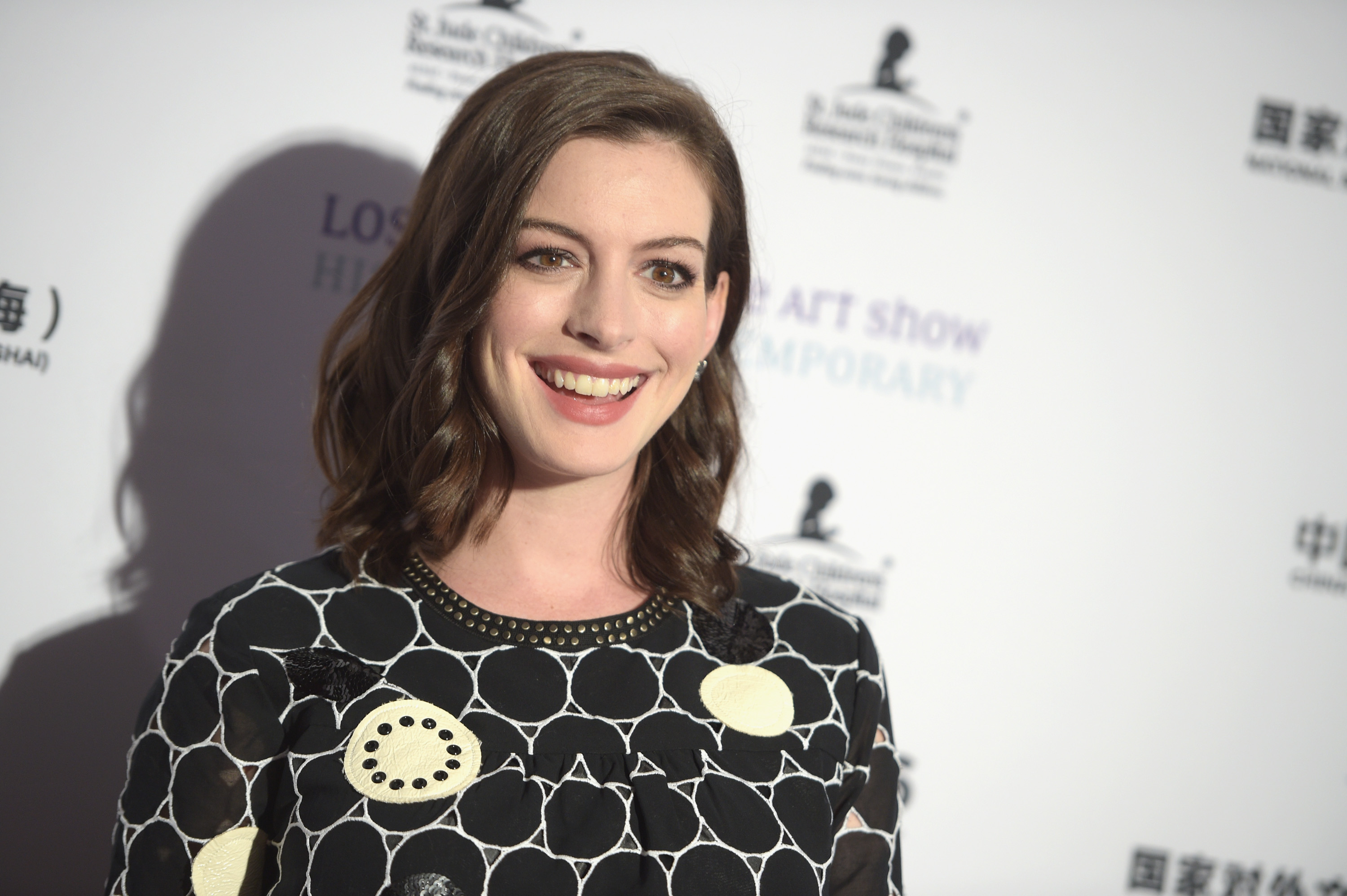 Anne Hathaway just wore black leather overalls, we are speechless