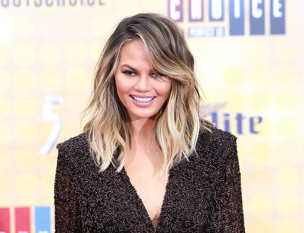 Chrissy Teigen devising a plan to tackle a football player is just stupid funny
