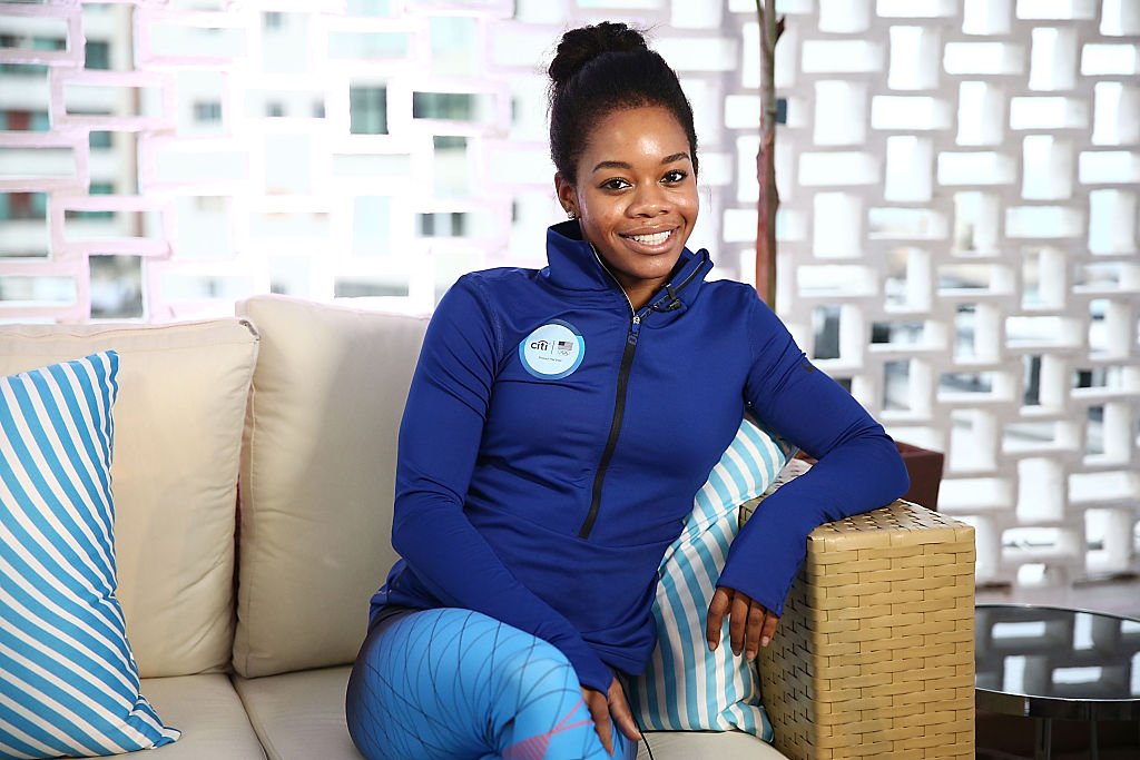 Olympic Gymnast Gabby Douglas is oh-so-pretty in pink at the Miss America Competition