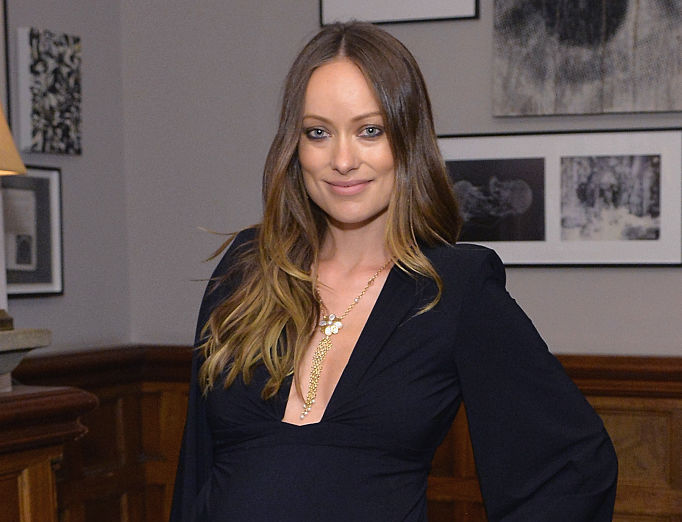 Olivia Wilde looks like a pregnant Morticia Addams in this dark maternity dress