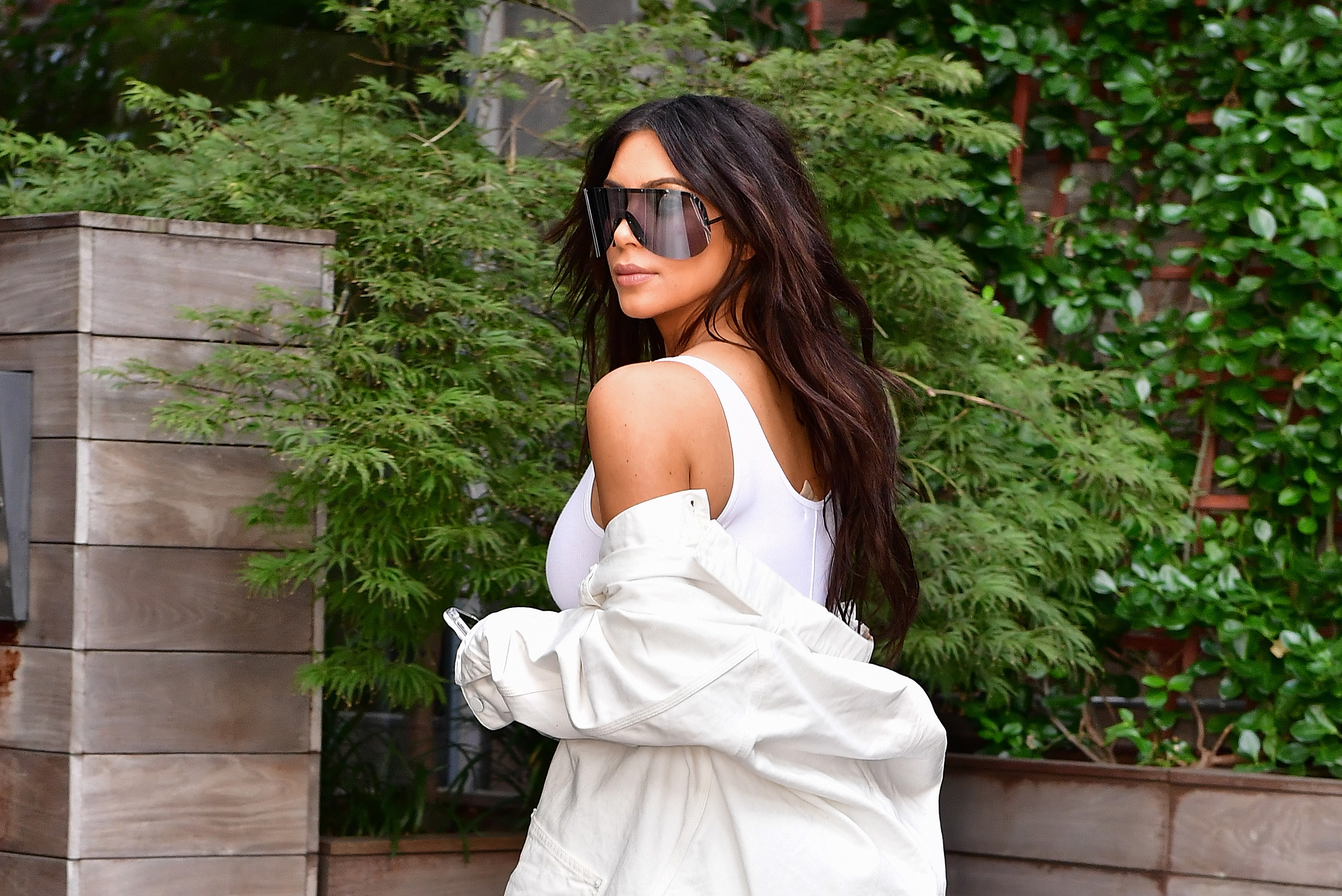 Kim Kardashian SLAYS IT in a casual black corset, leaving us to wonder, where can we get a casual corset?