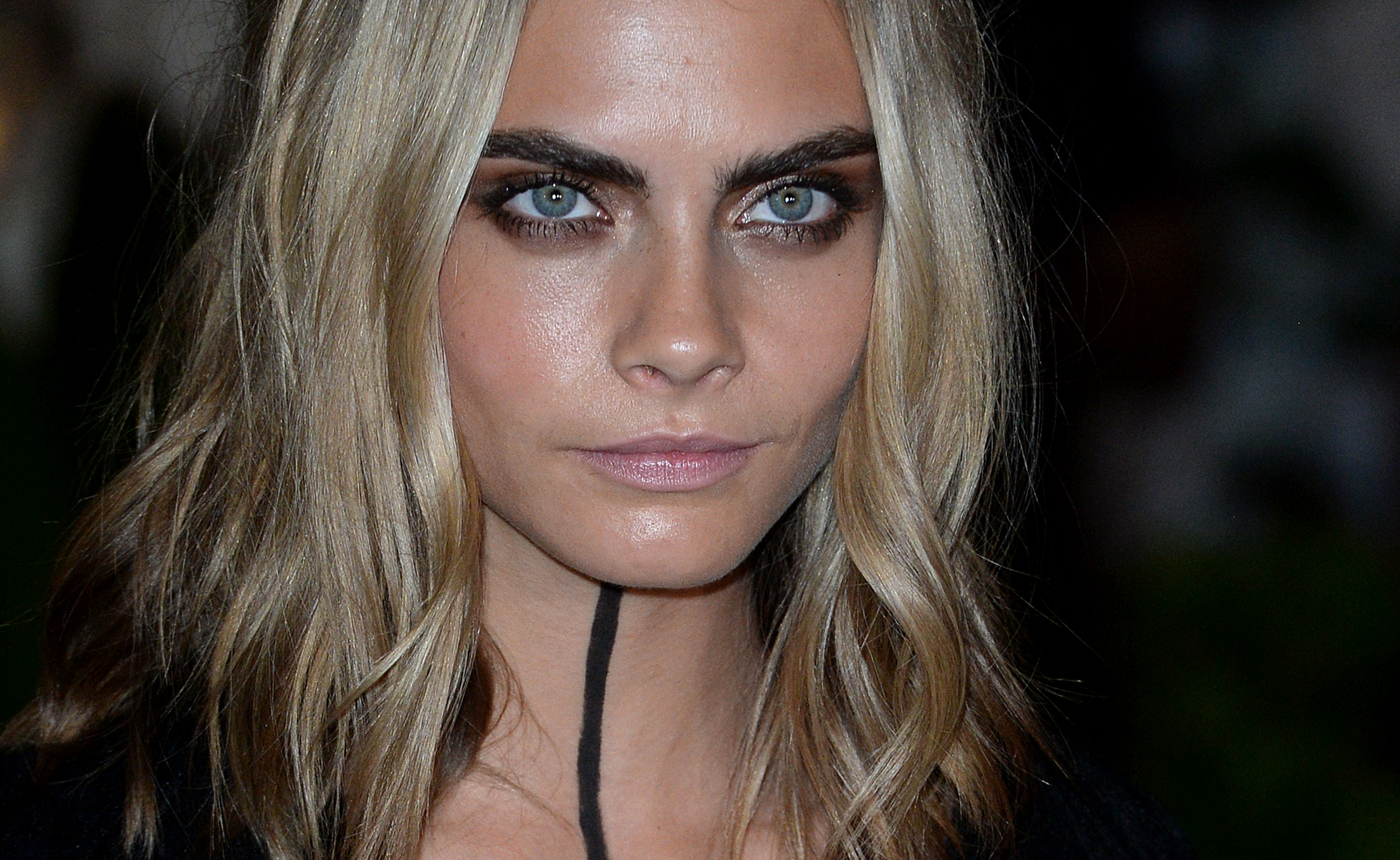 Cara Delevingne made ink black body paint a key part of her gothic ensemble
