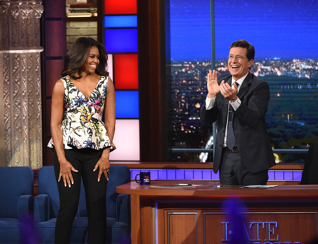We are cracking up at Michelle Obama's spot on impression of her husband