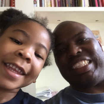 This dad doing his 3-year-old daughter's hair has won over the internet