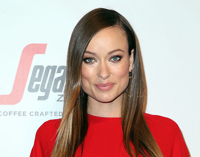 Olivia Wilde looks like a goddess of fire in this billowy maternity dress