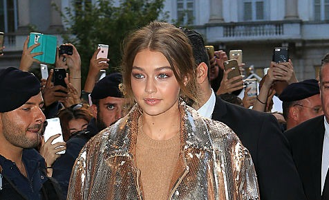 Gigi Hadid is a shimmering goddess in this stunning sequined trench coat