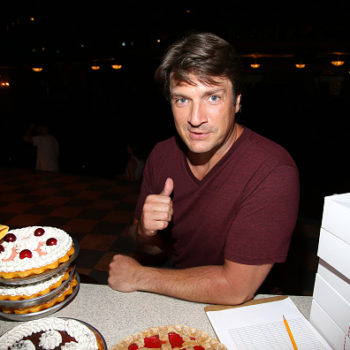 We cannot stop watching Nathan Fillion hypnotizing his dog