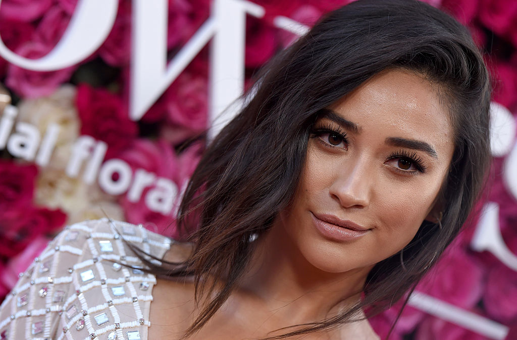 We're pretty sure this is the sweater of the year, and Shay Mitchell agrees