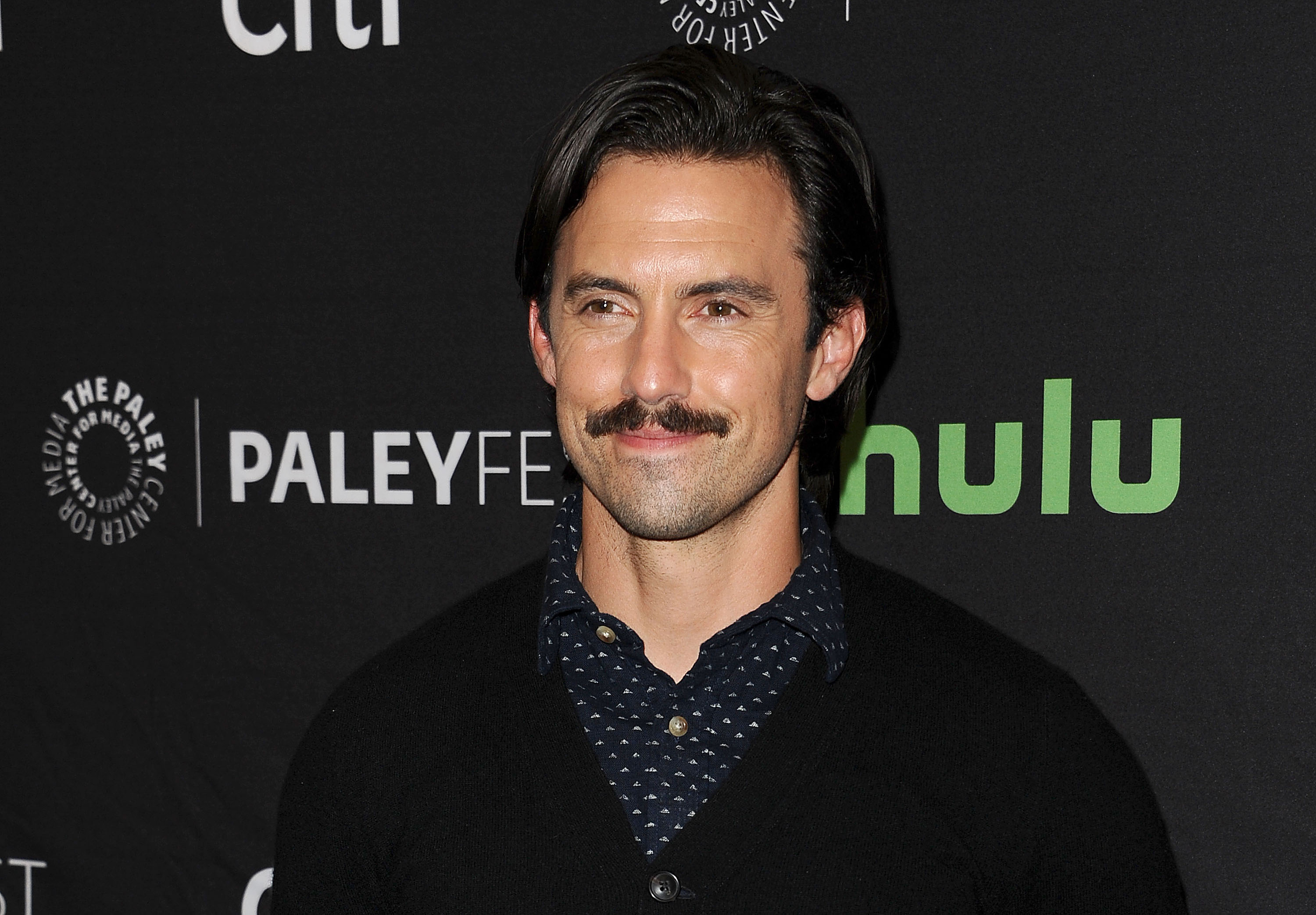 We now know why Milo Ventimiglia is rocking that awesome '80s 'stache, and it's a great reason