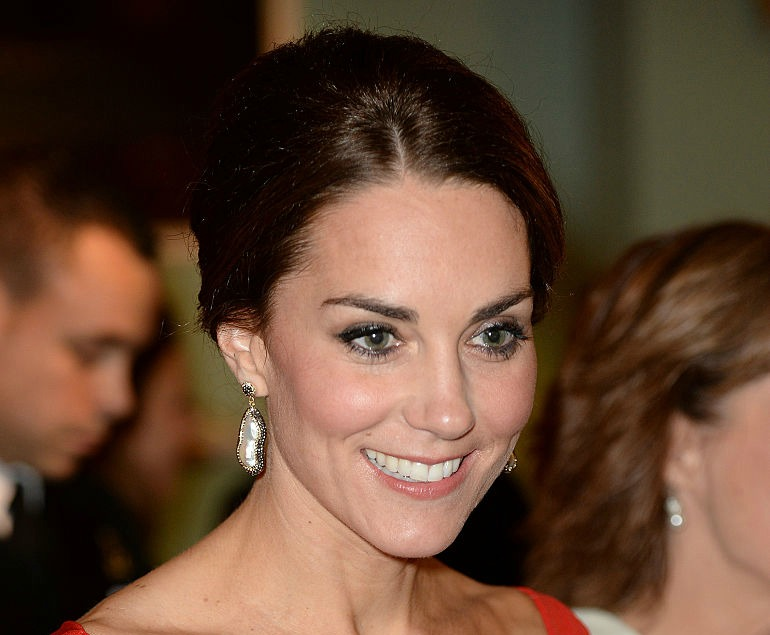 Kate Middleton is the dancing lady emoji brought to life in this dramatic red dress