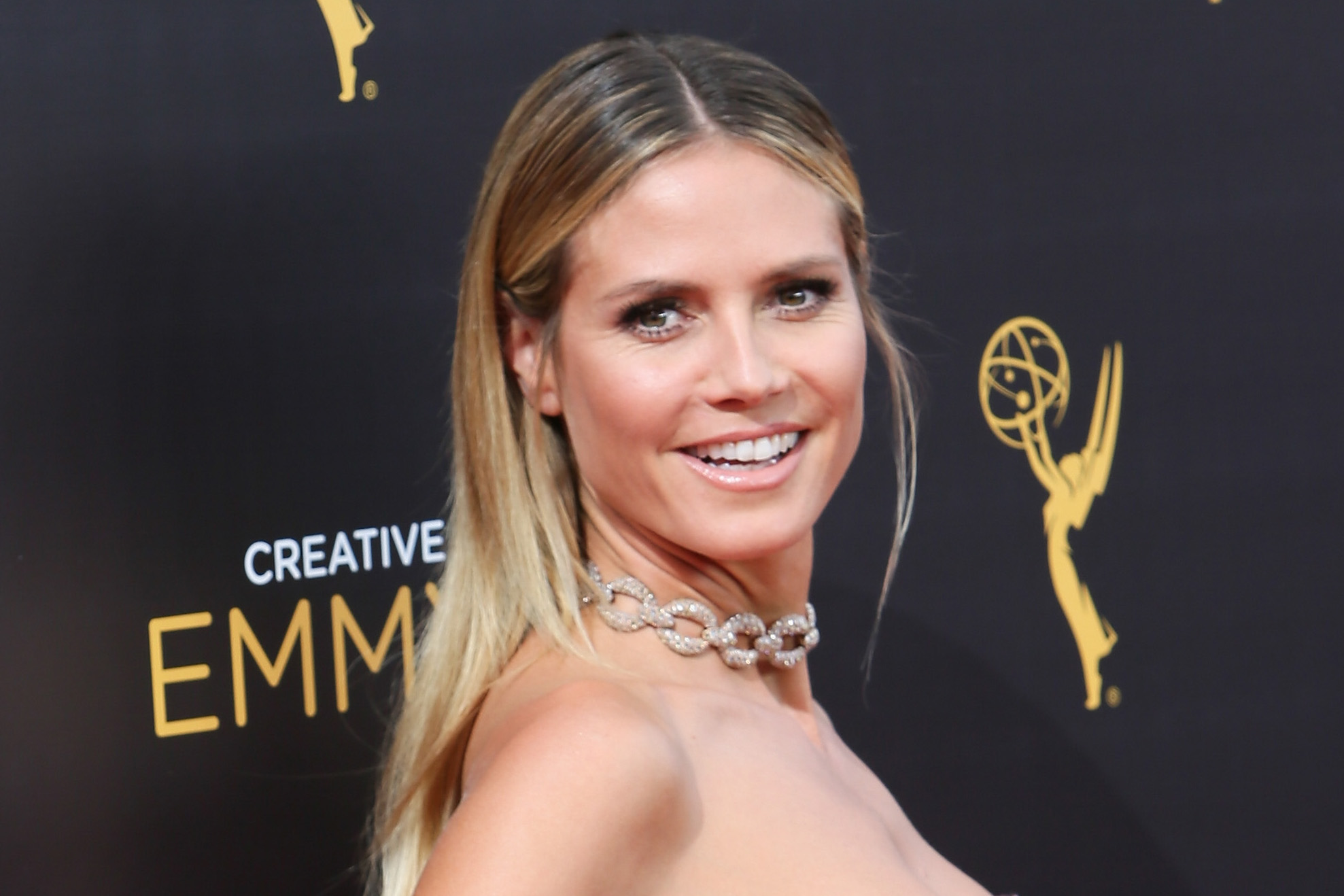 Heidi Klum goofing around on a swimsuit photo shoot is too cute for words