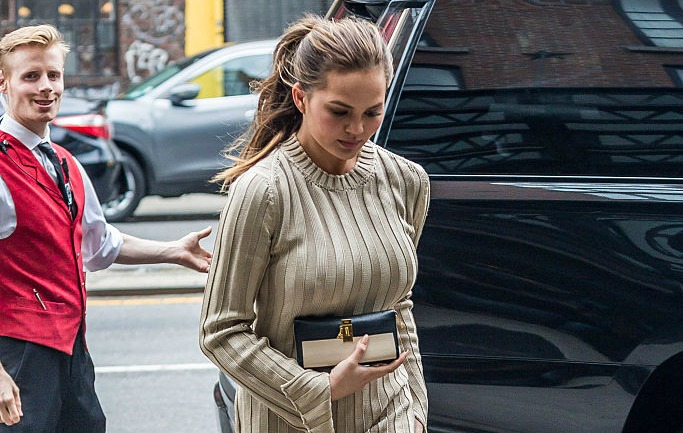 Chrissy Teigen's thigh-high boots and over-sized sweater dress is what autumn dreams are made of