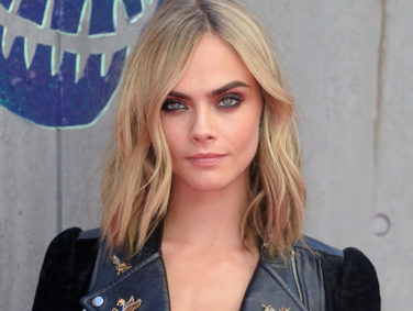 Cara Delevingne wore a onesie with leopards all over it for her sleepover with Taylor Swift