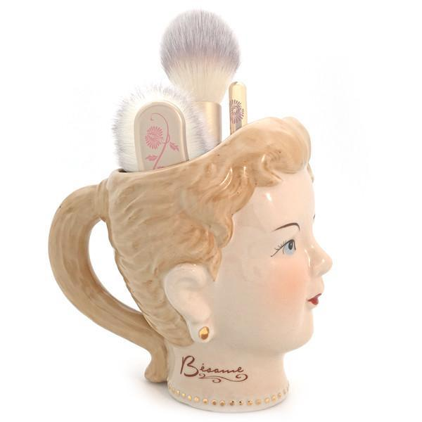 Forget that old coffee mug — keep your makeup brushes in this vintage-inspired holder from Besamé