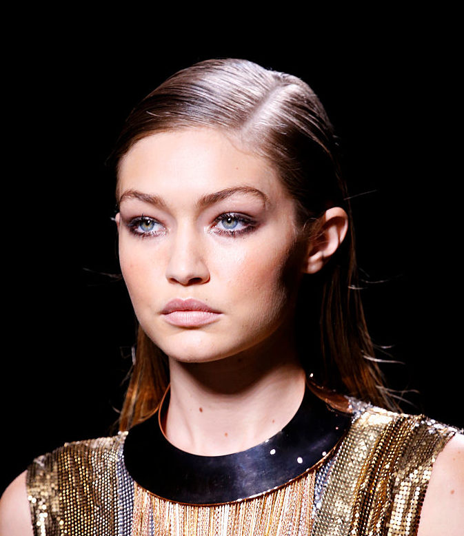 Welp, Gigi Hadid is officially making corsets-over-the-shirt a thing