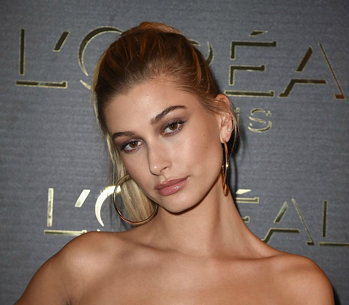 Hailey Baldwin wore ripped sweatpants with a see through turtleneck because #fashion