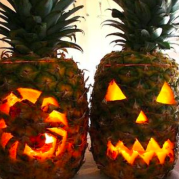 People are carving pineapples for Halloween instead of pumpkins and we kinda love it