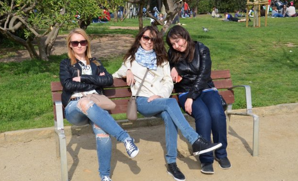 People are trying to figure out what's wrong with this photo of three women sitting on a bench