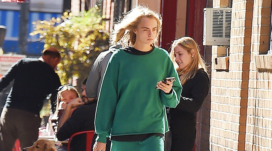 Cara Delevingne flawlessly pulls off casual green sweatsuit because duh, she's Cara Delevingne