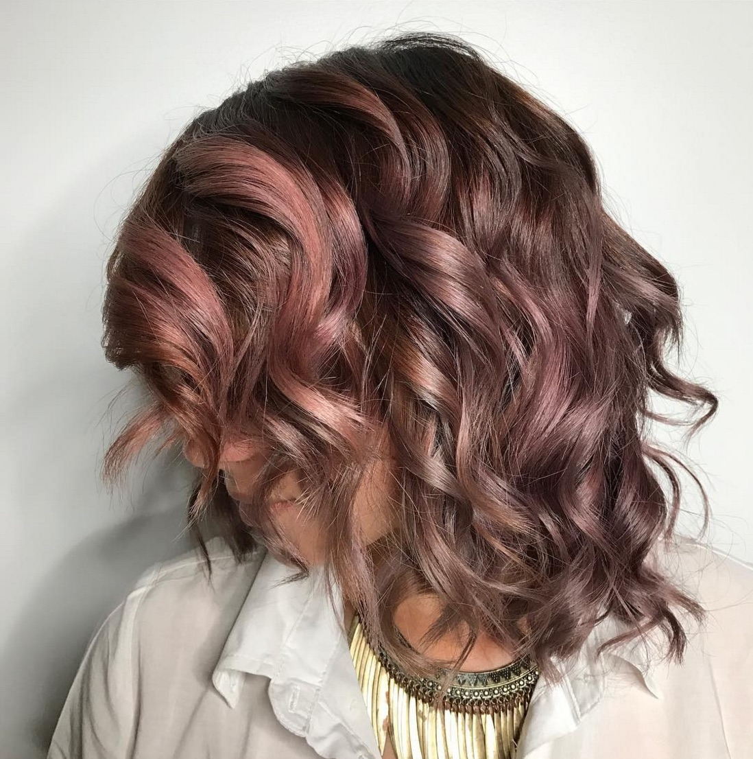We are obsessed with this deliciously beautiful chocolate mauve hair