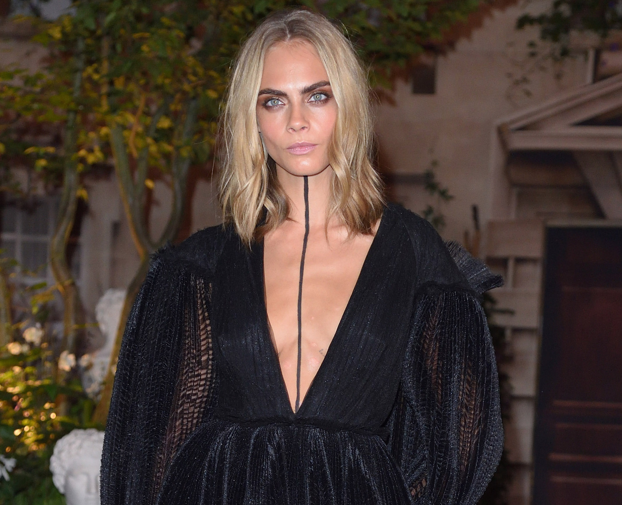 We're in love with the fact that Cara Delevingne went grandpa chic with a dark twist