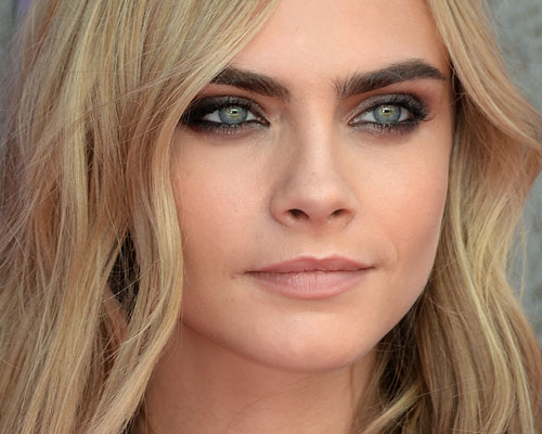 This video of Cara Delevingne surrounded by a giant bubble is spooky and mesmerizing and we can't stop watching