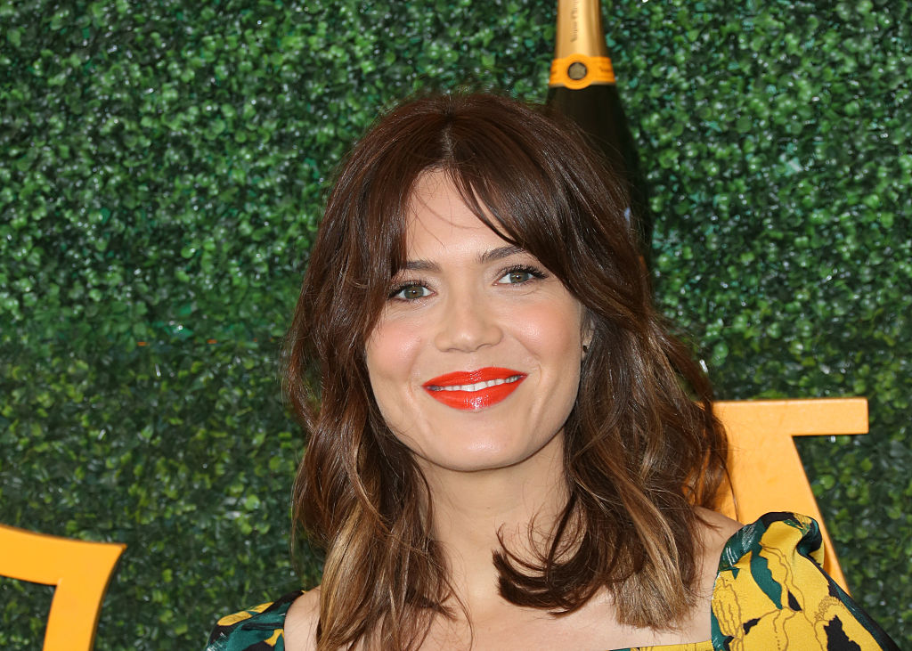 Mandy Moore looks like a floral dream in this colorful asymmetrical dress