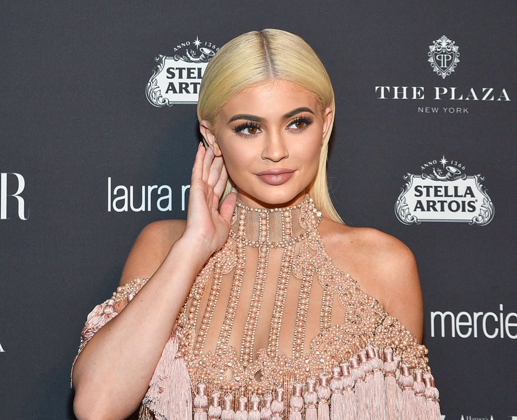 Kylie Jenner wears mirrored pink aviators for an *amazing* cause, we can do the same