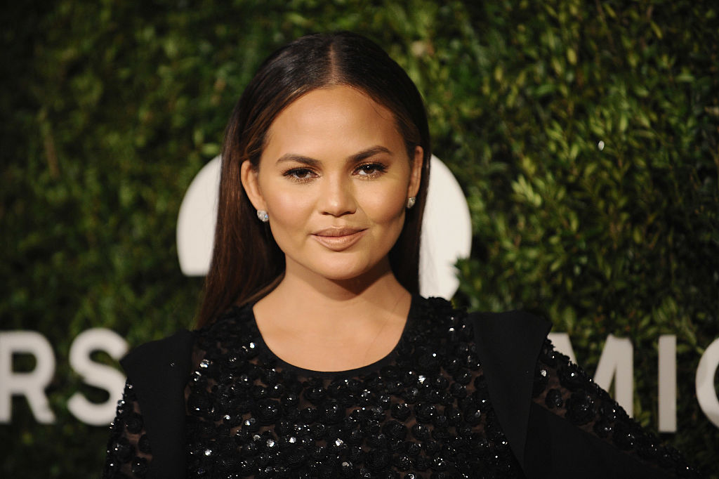 Chrissy Teigen looks like a sparkly goth goddess in this stunning pencil dress