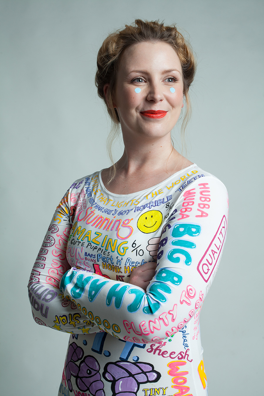 This artist designed a dress covered in all the things people have said about her body